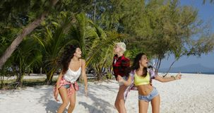 Cheerful Girls Dancing On Beach, Young Women Group Having Fun Together On Holiday