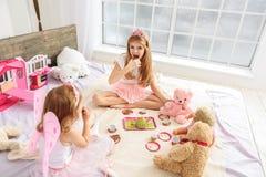 Cheerful girls enjoying sweet food at home Stock Photo