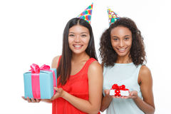 Cheerful girls holding birthday presents. Happy Birthday. Pleasant girls holding the presents in their hands and congratulating while smiling stock images
