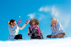 Cheerful girls playing in snowball outdoors Stock Photography