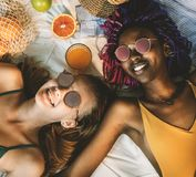 Cheerful girls in swimsuit sun tanning together Royalty Free Stock Photography