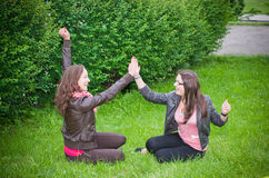 Cheerful girls teens. Cheerful happy girls teens in a meadow Stock Images
