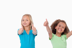 Cheerful girls with the thumbs up Royalty Free Stock Images