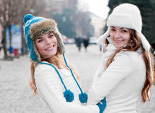 Cheerful girls twins, in the street. Two cheerful girls twins, in the street Royalty Free Stock Images