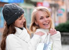 Cheerful girls twins, in the street Stock Images
