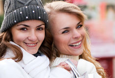 Cheerful girls twins, in the street. Two cheerful girls twins, in the street Royalty Free Stock Image