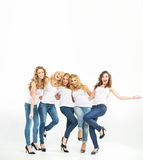 Cheerful and glad women posing together Stock Image