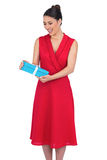 Cheerful glamorous model in red dress holding present Stock Photos