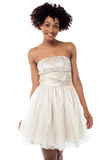 Cheerful glamorous model in white frock Stock Photo