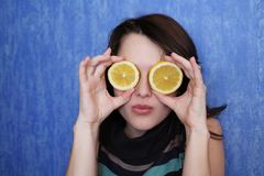 Cheerful glasses. Portrait of the girl with segments of a lemon instead of glasses Royalty Free Stock Image