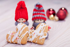 Cheerful gnomes holding xmas cookies Royalty Free Stock Photo