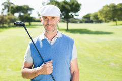 Cheerful golfer smiling at camera Stock Photography