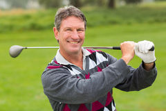 Cheerful golfer smiling at camera Stock Photos