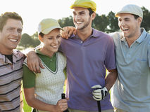 Cheerful Golfers On Golf Course Stock Photography