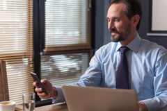 Cheerful good looking businessman making a call Stock Photo