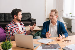 Cheerful good looking men having a conversation Royalty Free Stock Image