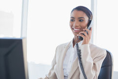 Cheerful gorgeous businesswoman on the phone Royalty Free Stock Photos