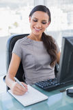 Cheerful gorgeous businesswoman taking notes Royalty Free Stock Photo