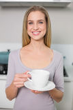 Cheerful gorgeous model holding plate with cup Stock Images