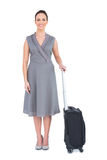 Cheerful gorgeous woman with her suitcase posing Royalty Free Stock Photo
