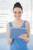 Cheerful gorgeous woman using tablet pc Royalty Free Stock Photos