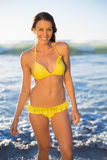Cheerful gorgeous woman in yellow bikini bathing in the sea Royalty Free Stock Photo