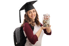 Cheerful graduate student holding a jar filled with money Royalty Free Stock Photos