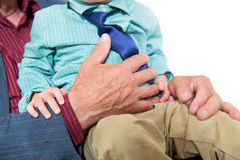 Cheerful grandfather and grandson sitting on the sofa Stock Photography