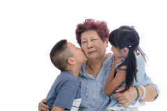 Cheerful grandmother and children portrait. On white background Royalty Free Stock Images