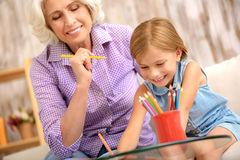Cheerful grandmother painting with child Royalty Free Stock Photo