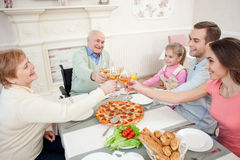 Cheerful grandparents are celebrating event with children Stock Image