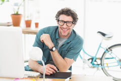 Cheerful graphic designer using a graphics tablet. In a modern office royalty free stock photography