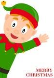 Cheerful Green Elf wishing Merry Christmas Stock Photo