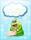 A cheerful green monster holding a card and a flower Stock Photo