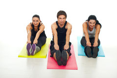 Cheerful group of fitness people stretch Stock Image