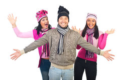 Cheerful group of friends in knitted clothes. Cheerful group of friends wearing colorful winter knitted clothes and cheering isolated on white background Stock Photography