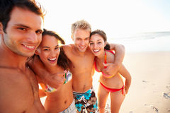 Cheerful group of friends at the sea shore Stock Photos
