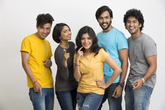 Cheerful group of Indian young friends pointing at the camera Stock Photo
