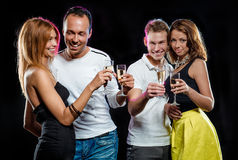 Cheerful group of people with glasses of champagne Stock Images