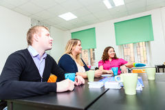 Cheerful group of people playing board game at table Royalty Free Stock Photo