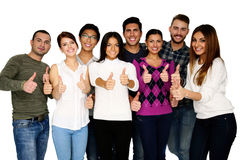 Cheerful group of people with thumbs up. Isolated over white Royalty Free Stock Images