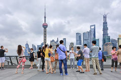 Cheerful group of tourists on Bund Boulevard, Shanghai, China Royalty Free Stock Photo