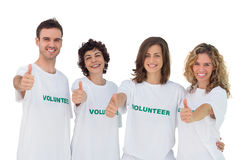 Cheerful group of volunteers giving thums up. On white background stock photography