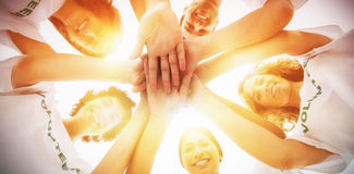 Cheerful group of volunteers putting hands together. On white background Royalty Free Stock Images