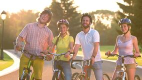 Cheerful group of young people with bicycles. stock footage