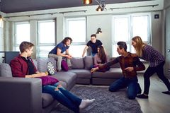 A cheerful group of young people play board games. royalty free stock photos