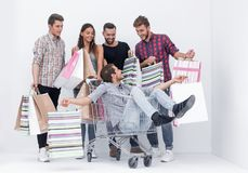 Cheerful group of young people with shopping bags royalty free stock images