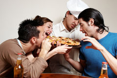Cheerful group of youth in a pizza Royalty Free Stock Image