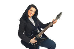 Cheerful guitarist woman in formal wear Royalty Free Stock Image