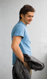 The cheerful guy. The young cheerful person in a blue T-shirt Stock Image